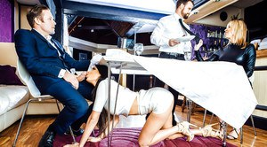 Horny brunette wife Anissa Kate giving oral sex under table in public