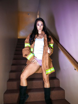 Top Asian pornstar Eva Lovia flashing in fireman's coat and boots