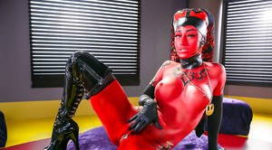 Cosplay model Kleio Valentien exhibiting pink pussy in long latex boots