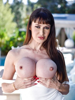 MILF Eva Karera exposing huge boobs outdoors before baring pink pussy