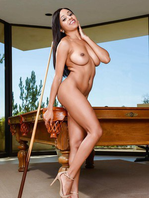 Ebony beauty Anya Ivy unveiling big natural black tits on pool table