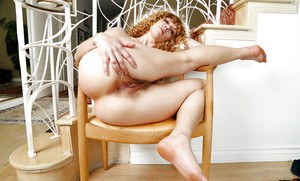 Mature hirsute dame Leona tugging on labia lips to stretch hairy cunt open