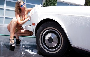 Wet pornstars August Ames and Darcie Dolce having lesbo sex during carwash