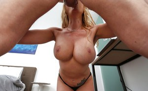 Blonde MILF Briana Banks unveiling boobs before blowing big cock in glasses