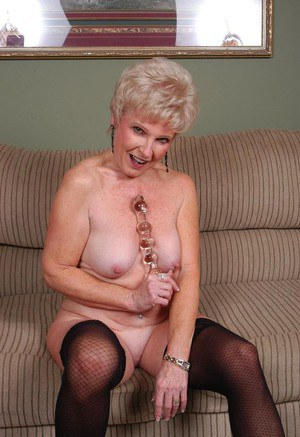 Grey haired granny Jewel stripping down to nylons for toying of horny pussy