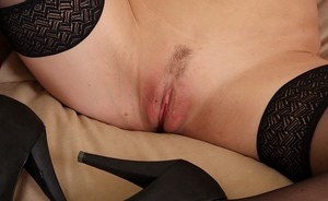 Euro mom Valentine Chevalier peels off see thru lingerie to pose in nylons