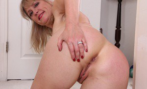 Chubby aged MILF Rebecca Hill masturbating bald twat after baring tiny tits