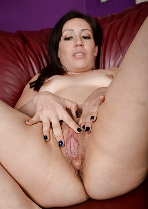 Older solo model Lisa Smith stretching hairy twat wide open