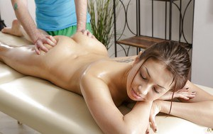 Naked young girl Jordan C receiving hot oil massage and pussy fingering