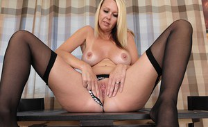 Blonde mom Kylie Deville slipping off panties before flaunting large boobs
