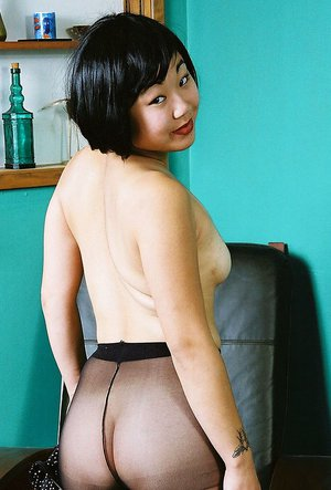 Amateur Korean model Junko posing topless in black pantyhose
