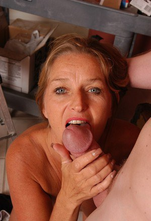 Aged blonde lady Vickie licking large cock with tongue while giving head