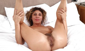 Leggy MILF French Chloe slipping off cotton panties to expose hairy snatch