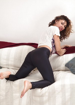 Barefoot Euro mom French Chloe slides yoga pants and undies over legs and bush