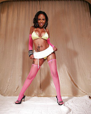 Black MILF pornstar Lacey DuValle showing off oiled booty in pinks stockings