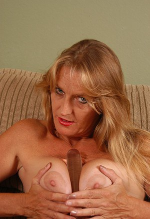 Older blond lady Vickie displaying large saggy boobs before sex toy insertion