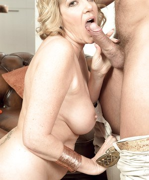 Older blonde Amy giving BJ before fucking of pierced cunt in tan nylons