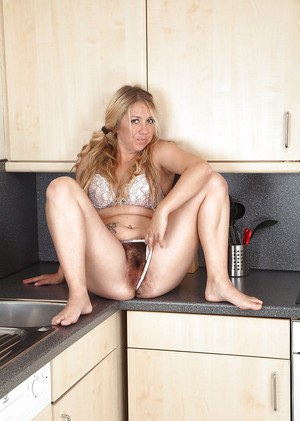 Chubby aged Euro Elle Macqueen revealing hairy cooter in kitchen