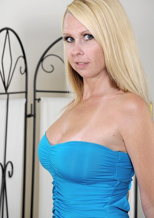 Older blonde lady Kylie Deville letting big boobs free from dress in heels