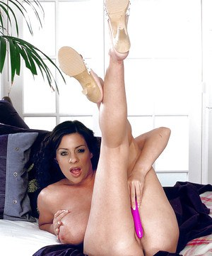 European mom Linsey Dawn McKenzie exhibiting hooters while toying hairy twat