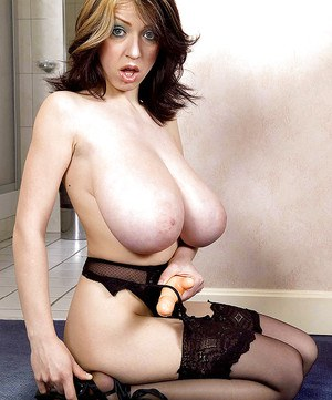 MILF model Merilyn Sakova revealing huge saggy tits before toying in stockings