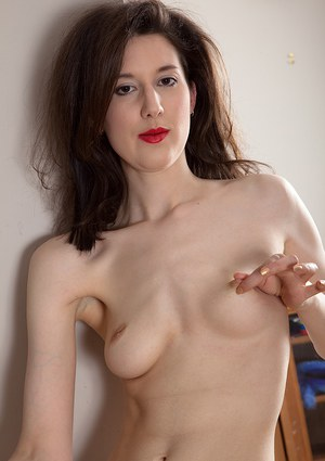 Brunette mom Tiffanny disrobing for baring of perky tits and hairy vagina