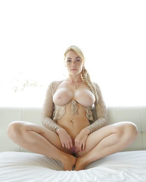 Freckle faced pornstar Skyla Novea exposing massive all natural hooters