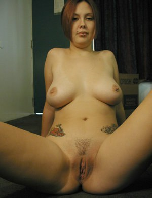 Amateur redhead Gwen displaying bald Asian twat before baring big natural tits
