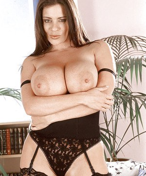 Buxom MILF Linsey Dawn McKenzie freeing hairy pussy from panties in stockings