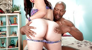 Chunky chick Carmen Ross displaying huge ass during interracial sex in socks