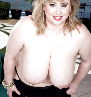 BBW solo girl Laddie Lynn releasing massive tits from bra in high heeled shoes