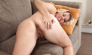 Older Euro lady Elle Macqueen freeing really hairy bush from pink panties