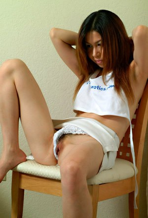 Asian amateur Cybele slips fingers into hairy cunt after lace panty removal