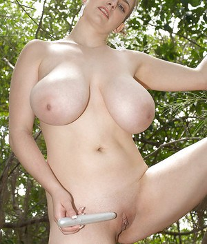 Chunky solo girl Christy Marks flaunting hooters while masturbating in forest
