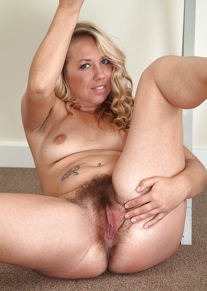Older European woman Elle Macqueen baring tiny tits and beaver while disrobing