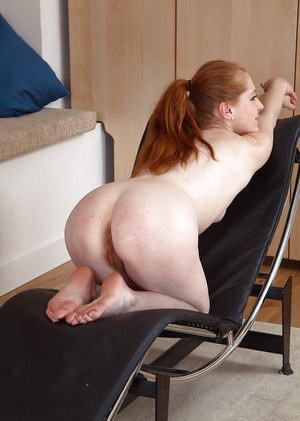 Leggy older redhead Tia Jones shedding red jeans and panties to expose beaver