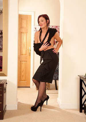 Mature Euro broad Sofia Matthews flaunting hairy bush in stockings and garters