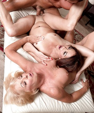Mature woman Renee Black and busty gf ride and suck cock in threesome