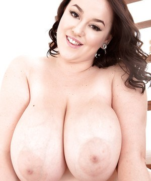 Thick brunette model Lila Payne revealing massive boobs in glasses and boots