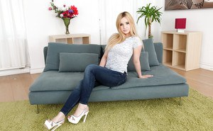 European teen Cherry Bright stripping off jeans and panties to pose naked