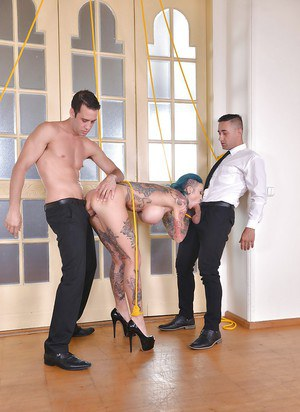 Heavily inked European MILF Calisi Ink receiving double penetration in bondage