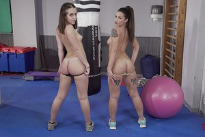 Fit lesbians Medusa and Zoe Doll free hot asses from yoga pants and shorts