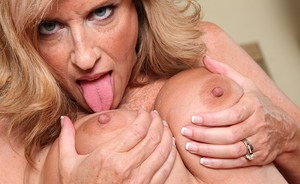 Older lady Jodi West releasing big tits from bra before masturbating in nylons