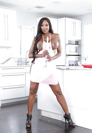 Ebony MILF pornstar Diamond Jackson posing naked in kitchen after disrobing