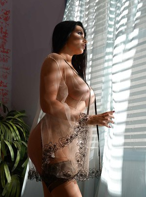 MILF pornstar Romi Rain shedding sexy lingerie to model naked in hot stockings