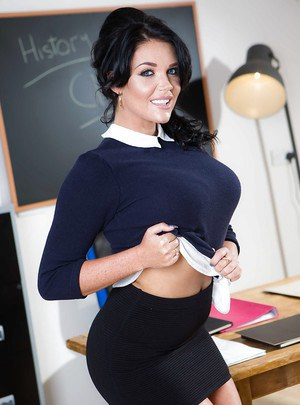 Brunette coed Emma Leigh freeing huge boobs from bra in classroom