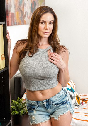 MILF pornstar Kendra Lust removing denim shorts and panties to model nude