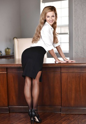 Blonde teen Bella Rose modeling naked in stockings on office desk
