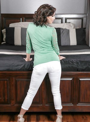 MILF Veronica Avluv showing off big tits and great legs in high heels