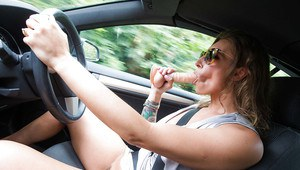 Euro MILF Ava Austen toying pussy while driving before posing naked outdoors